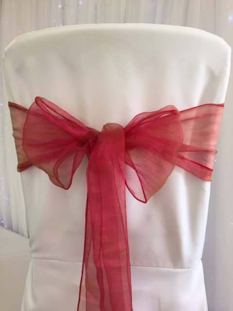 Poppy pink organza. Hire price £1. Replacement value £3 each