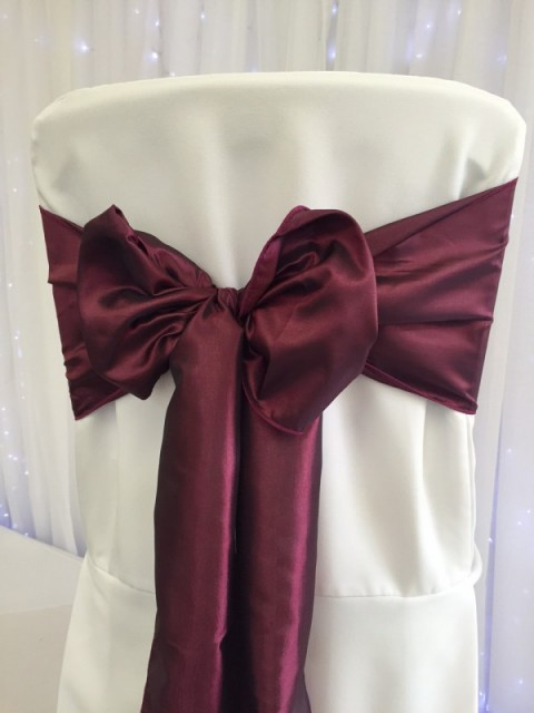 Burgundy taffeta. Hire price £1. Replacement value £5 each.