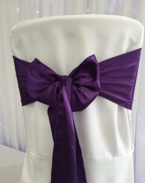 Purple satin. Hire price £1. Replacement value £4 each.