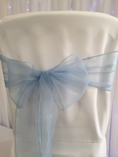 Wedgewood blue organza. Hire price £1. Replacement value £3 each.