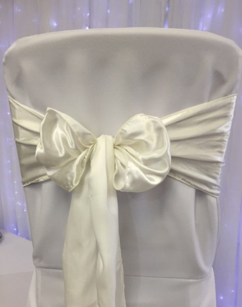 Ivory satin. Hire price £1. Replacement value £4 each.