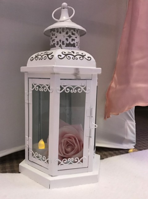White lace lantern. Hire cost including candle £3. Replacement value £10 each
