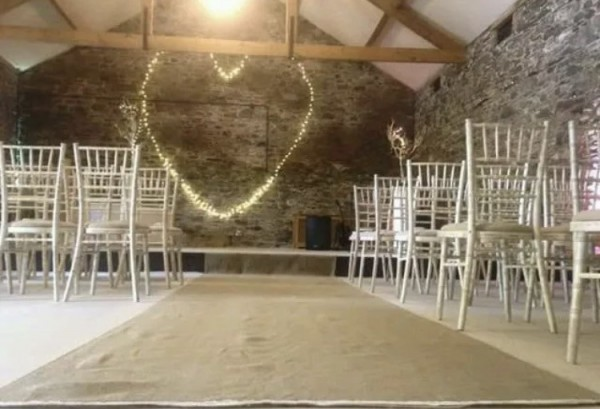 Hessian aisle runner. £40. Replacement value £100.