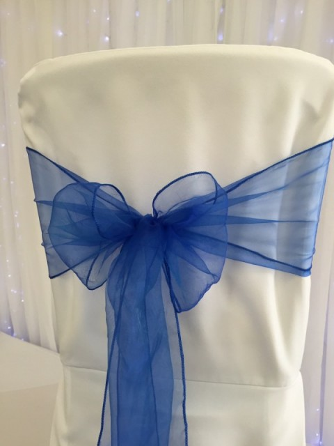 Royal blue organza. Hire price £1. Replacement value £3 each.