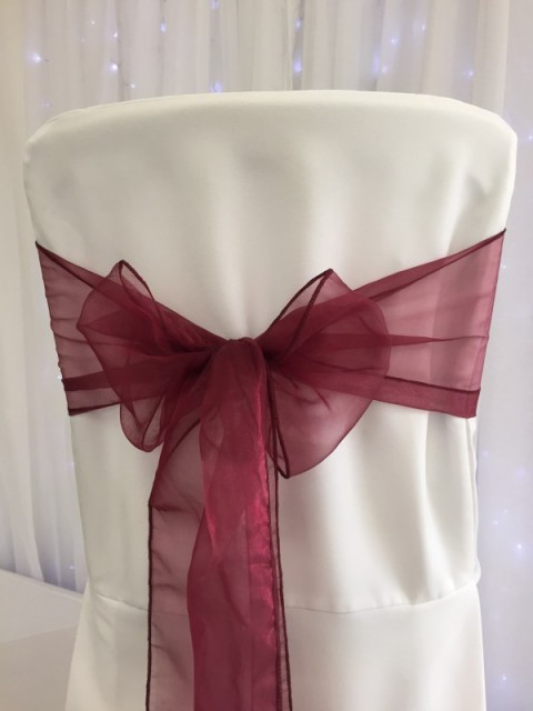 Burgundy organza. Hire price £1. Replacement value £3 each.
