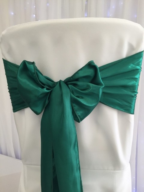 Hunter green satin. Hire price £1. Replacement value £4 each.