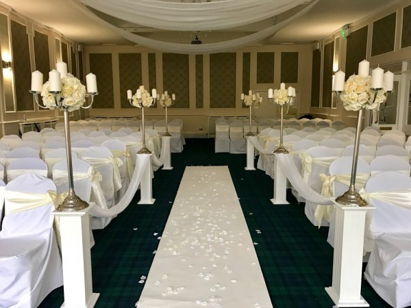 Aile set up with large candelabra on top of plinths