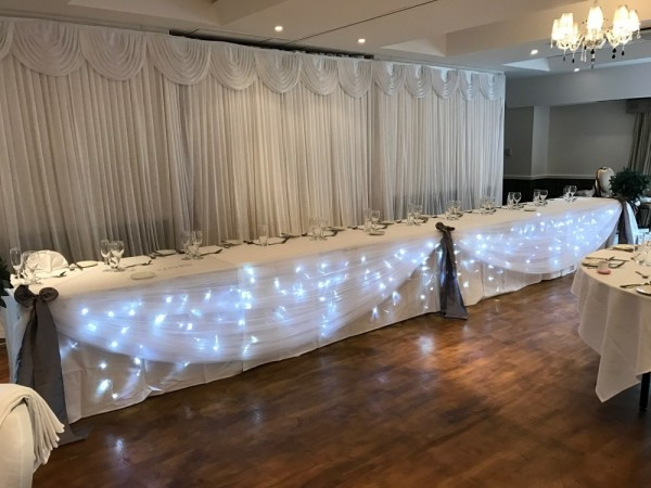 Cool white lighted top table. £50. Replacement value £150.