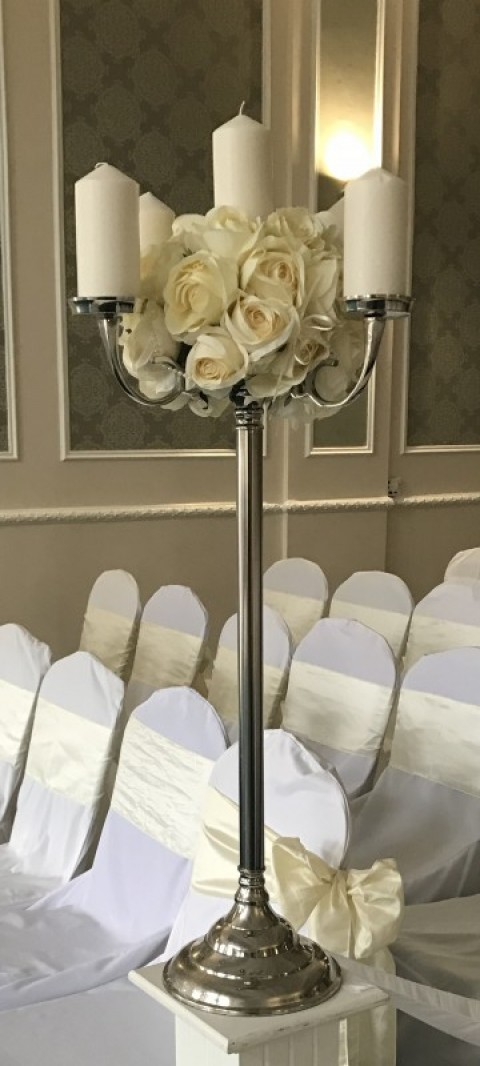Large silver five arm candelabra dressed with artificial ivory roses