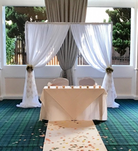 White voile frame for end of aisle