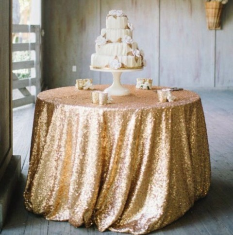 Champagne gold sequin 130 round. £20. Replacement value £100
