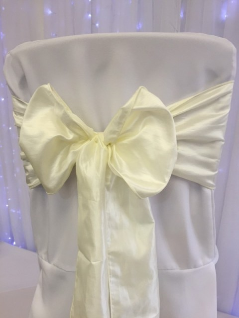 Ivory taffeta. Hire price £1. Replacement value £5 each.