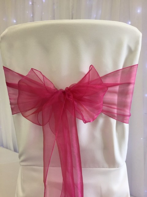 Hot pink organza. Hire price £1. Replacement value £3 each