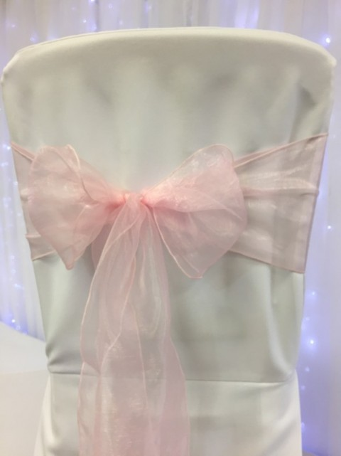Baby pink organza. Hire price £1. Replacement value £3 each.