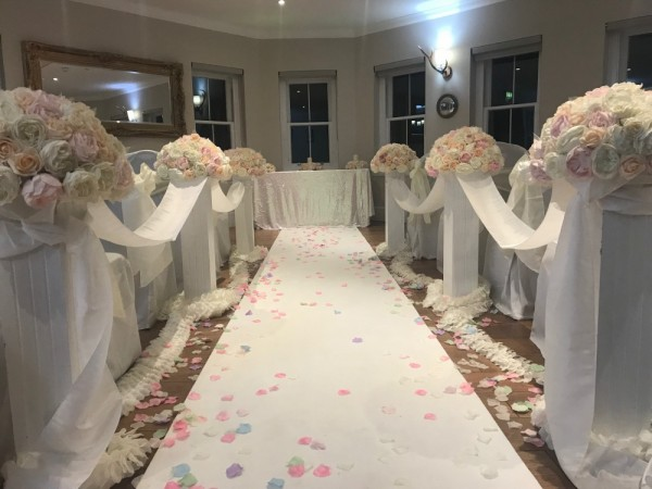 Another aisle set up using brides floral toppers