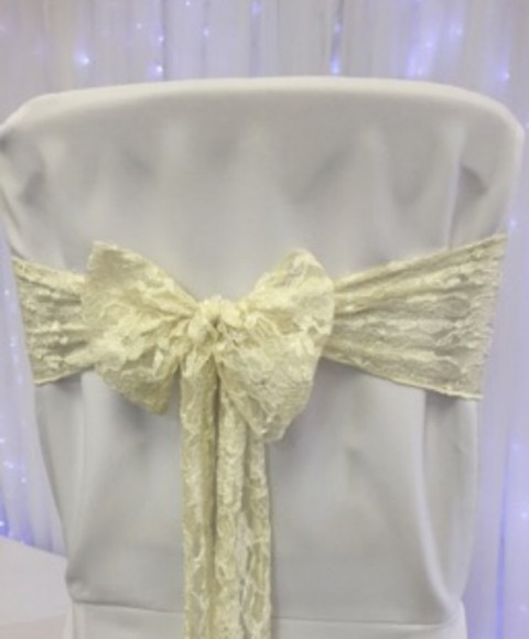 Ivory lace sash. £1.25 to hire. Replacement value £5 each.