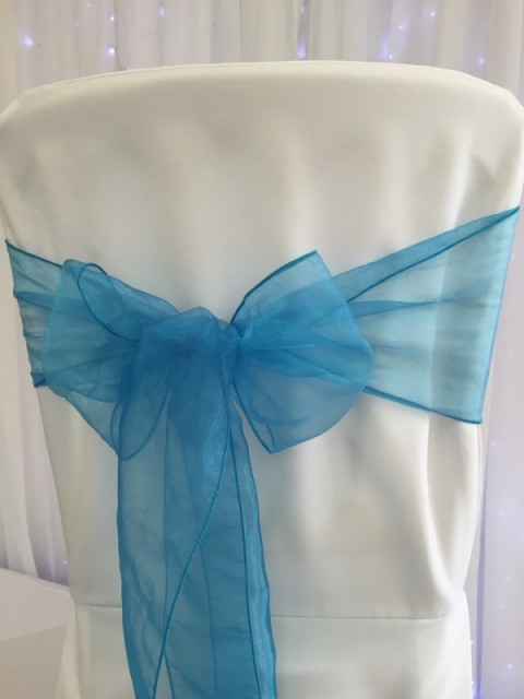 Turquoise blue organza. Hire price £1. Replacement value £3 each.