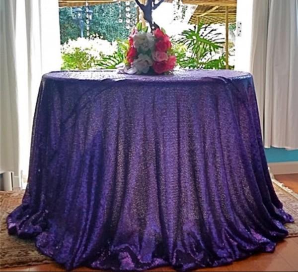 Purple sequin 130 round. £20. Replacemetn value £100