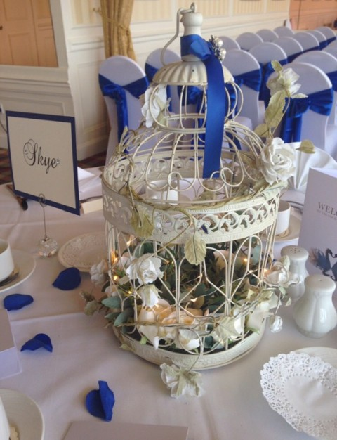 Large ivory birdcage with micro lights and ivory flower garland