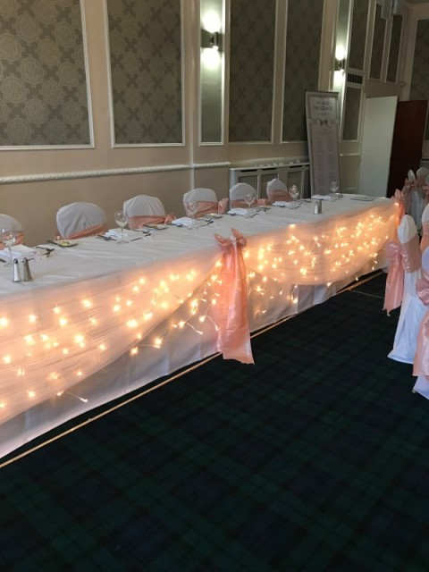 Warm white lighted top table. £50. Replacement value £150.