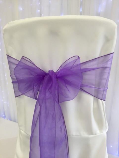 Light Cadbury purple organza. Hire price £1. Replacement value £3 each.
