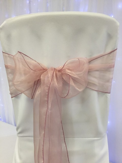 Dusky pink organza. Hire price £1. Replacement value £3 each.