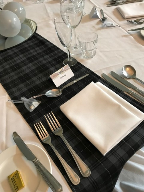 Grey Granite tartan runner. £5 each to hire, replacement value £20.00