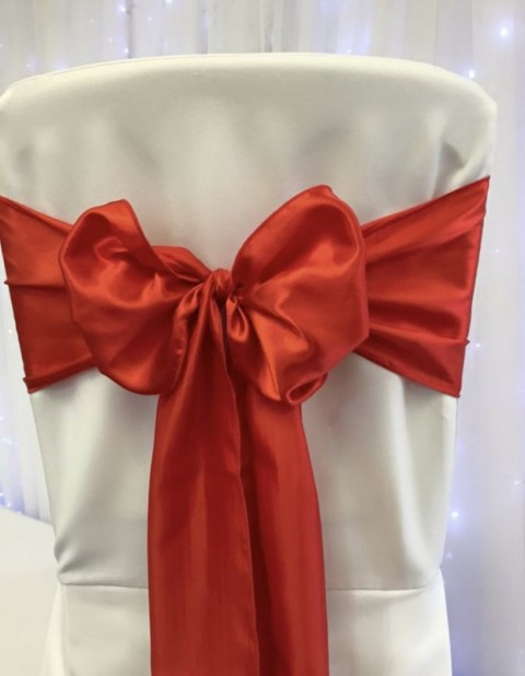 Flame red satin. Hire price £1. Replacement value £4 each.