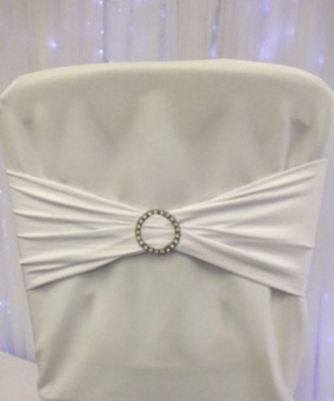 White stretch band with diamante jewel. £1.25 to hire. Replacement value £5 each