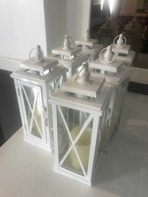 White coach lantern. Hire cost £3including candle. Replacement value £10 each