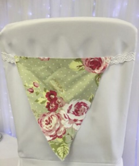 Floral bunting sash. £1 to hire. Replacement value £5 each.