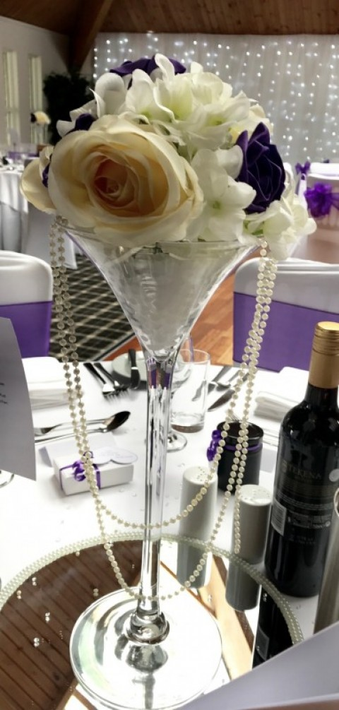Martini vase with flowers and hanging pearls