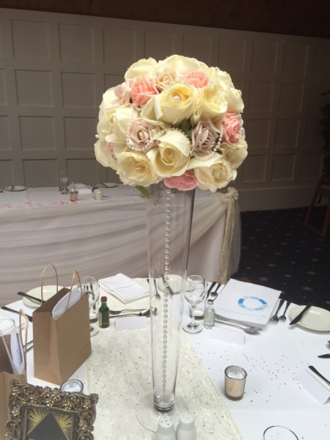 Pastel coloured rose ball with hanging pearl chain