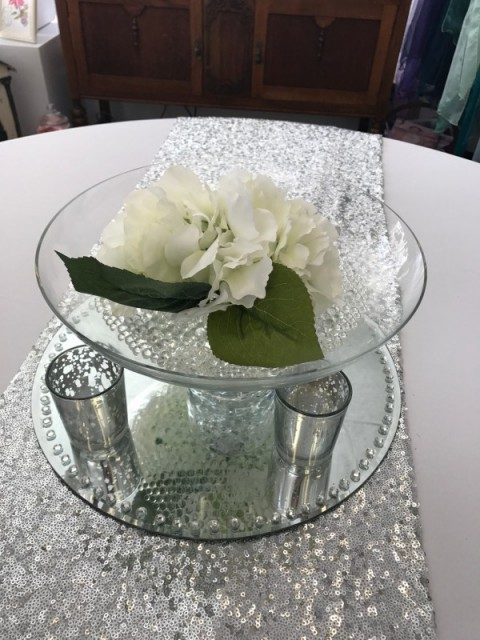 Glass footed bowl with white artificial floral head