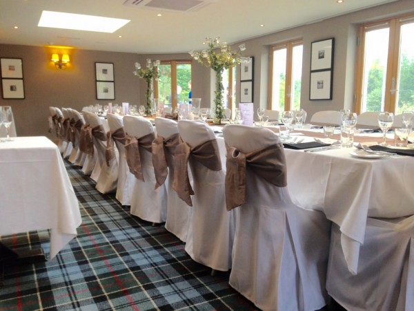 White hand ironed chair covers at The Inn on Loch Lomond