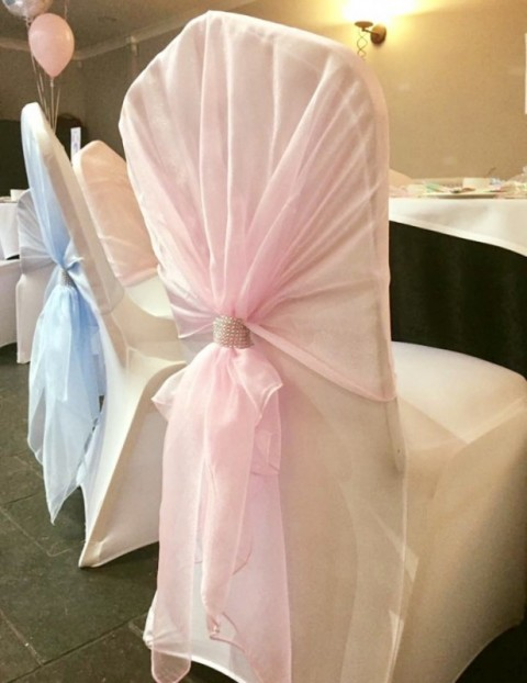 Baby pink organza hood. £2.00 each, replacement value £10.00 each