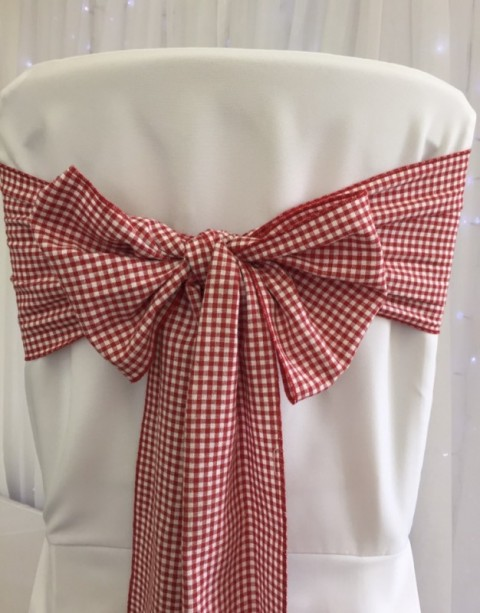 Red gingham sash. £1.25 to hire. Replacement value £5 each.