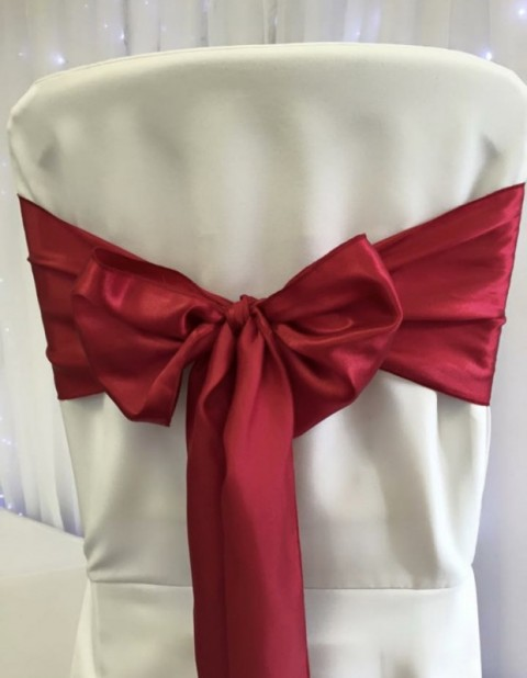 Red satin. Hire price £1. Replacement value £4 each.