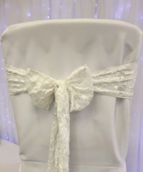 White lace sash. £1.25 to hire. Replacement value £5 each.