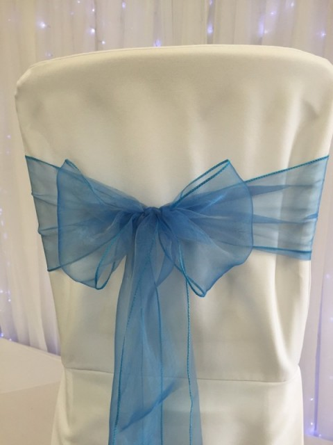 Azure blue organza. Hire price £1. Replacement value £3 each.