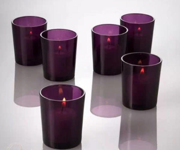 Purple glass votive. Hire cost including votive 50p each. Replacement value £3 each.