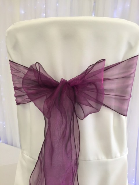 Violet organza. Hire price £1. Replacement value £3 each.