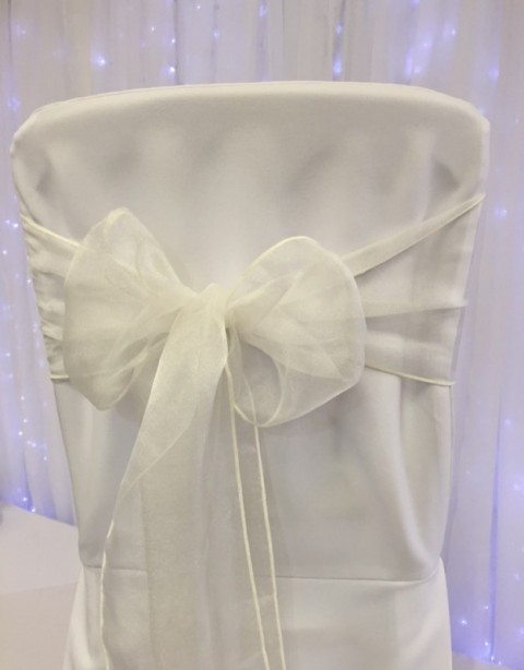 Ivory organza. Hire price £1. Replacement value £3 each.