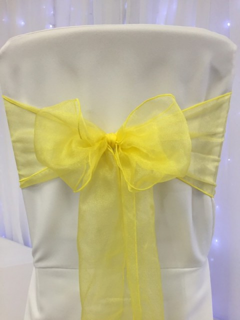 Yellow organza. Hire price £1. Replacement value £3 each.