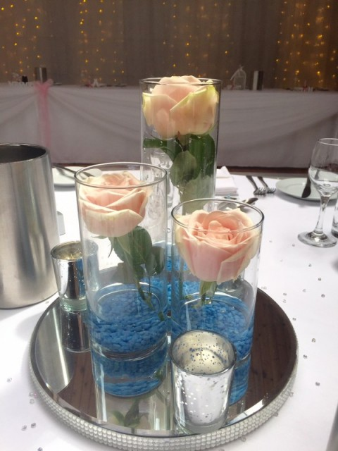 Tube vases filled with roses