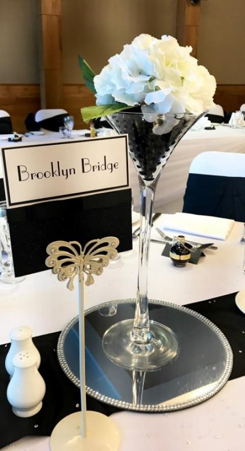Black bead filled martini vase with white hydrangea head