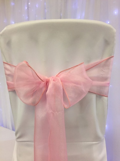 Bubblegum pink organza. Hire price £1. Replacement value £3 each.