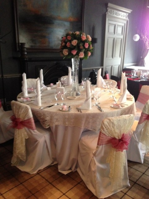 White hand ironed chair covers at Cameron House