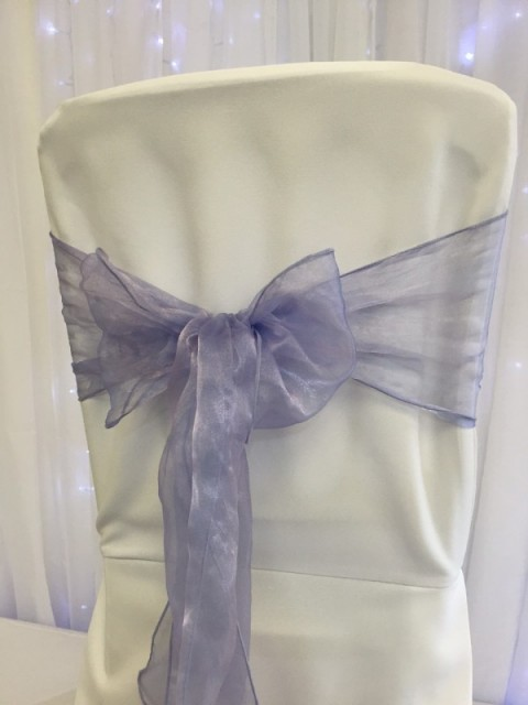 Lilac organza. Hire price £1. Replacement value £3 each.