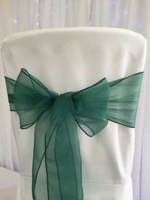 Hunter green organza. Hire price £1. Replacement value £3 each.